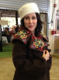 A visitor to our booth was happy to model an knitted Angora Blizzard hat and a felted coat.