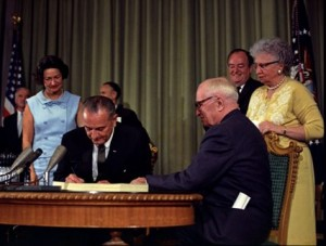Lyndon_Johnson_signing_Medicare_bill,_with_Harry_Truman,_30_July,_1965
