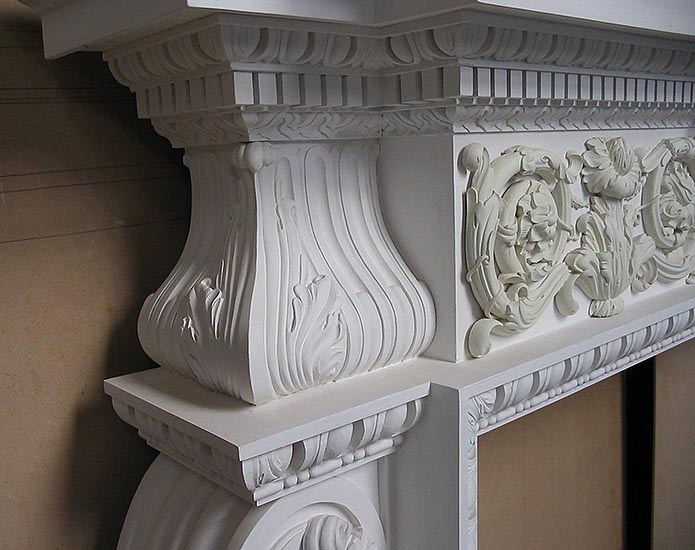 Detail of Georgian style fireplace. Carved and painted Limewood. Private client.