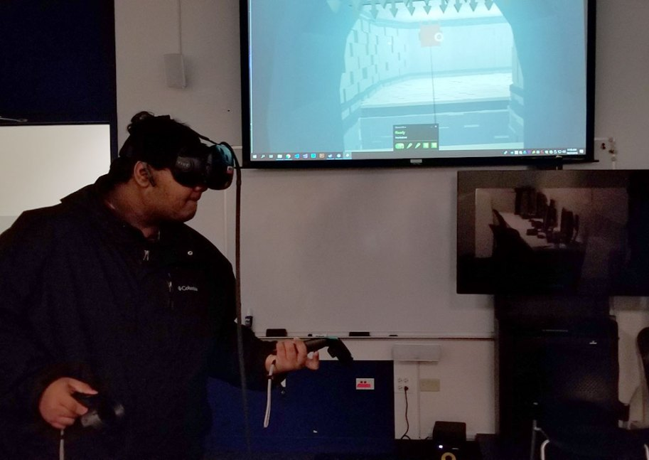Student playing a VR game developed by IAM students