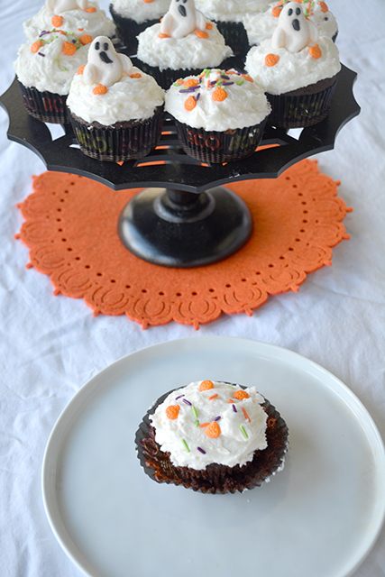 Halloween themed Chocolate Cupcakes with vanilla frosting on spider web cake stand