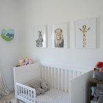 view of boys bed room with crib and animal prints