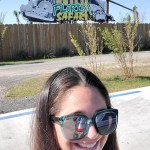 women takes selfie in front of wild florida sign