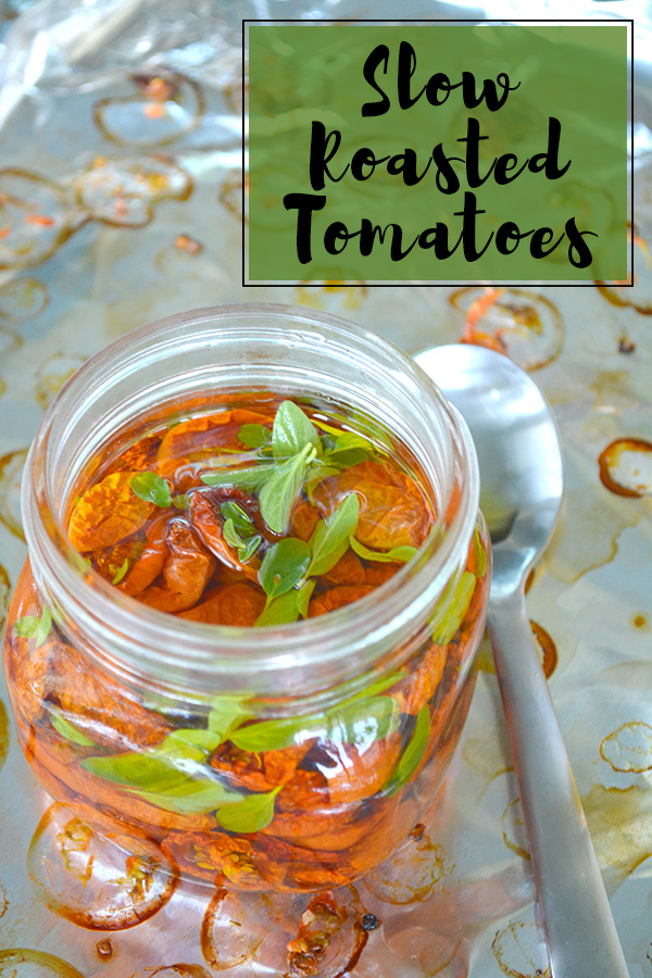 oil filled wide mouthed mason jar of slow roasted tomatoes with caption for Pinterest