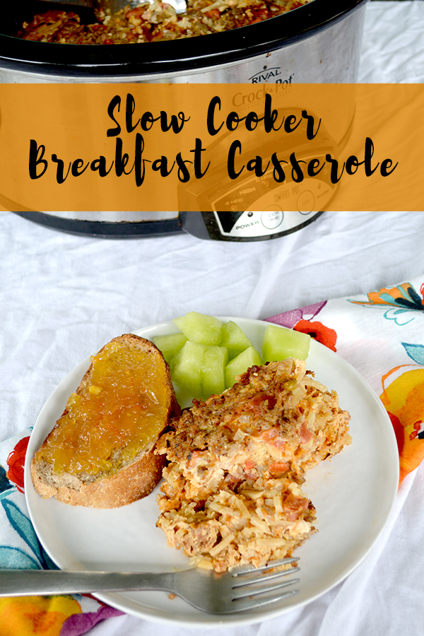 Slow Cooker Breakfast Egg Casserole on a white plate next to toast and melon in front of a slow cooker with text on top