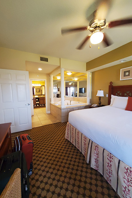 View of bed and whirl pool tub in Deluxe One Bedroom Room at Westgate Tower Center Resort