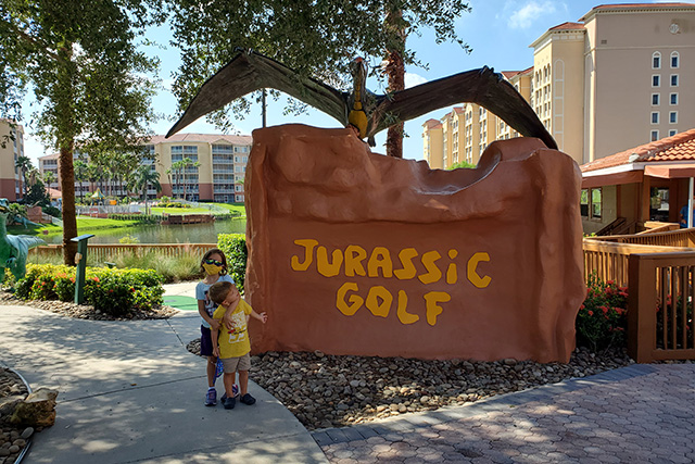 Young girl hugging little boy in front of mini golf sign at Westgate Resort
