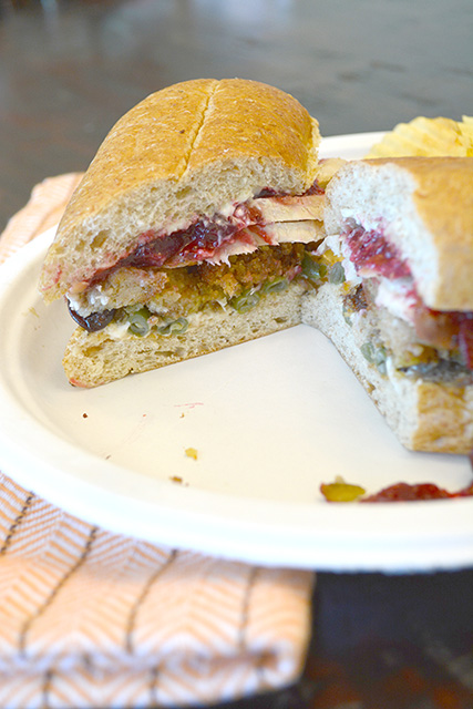 Cut Pilgrim Sandwich showing Thanksgiving Leftovers inside