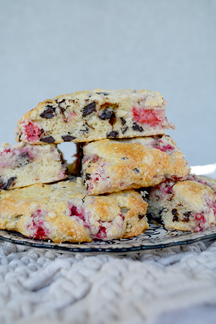 Stack of Raspberry Chocolate Chunk Scones on a black and white plate
