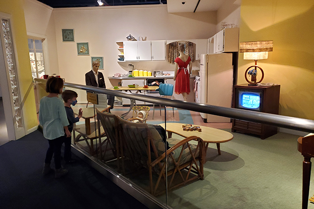 2 kids looking at a display of a 1950's house in Jacksonville MOSH