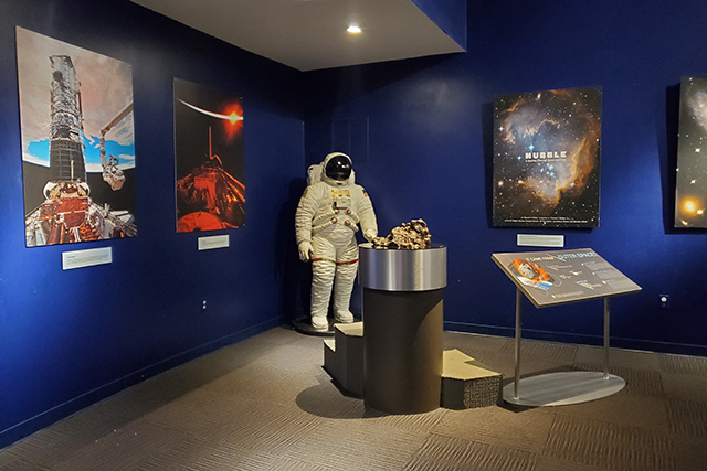 outer space display with replica space suit in Jacksonville MOSH