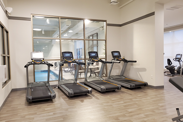 row of treadmills inside fitness center in Sheraton Hotel in Jacksonville FL