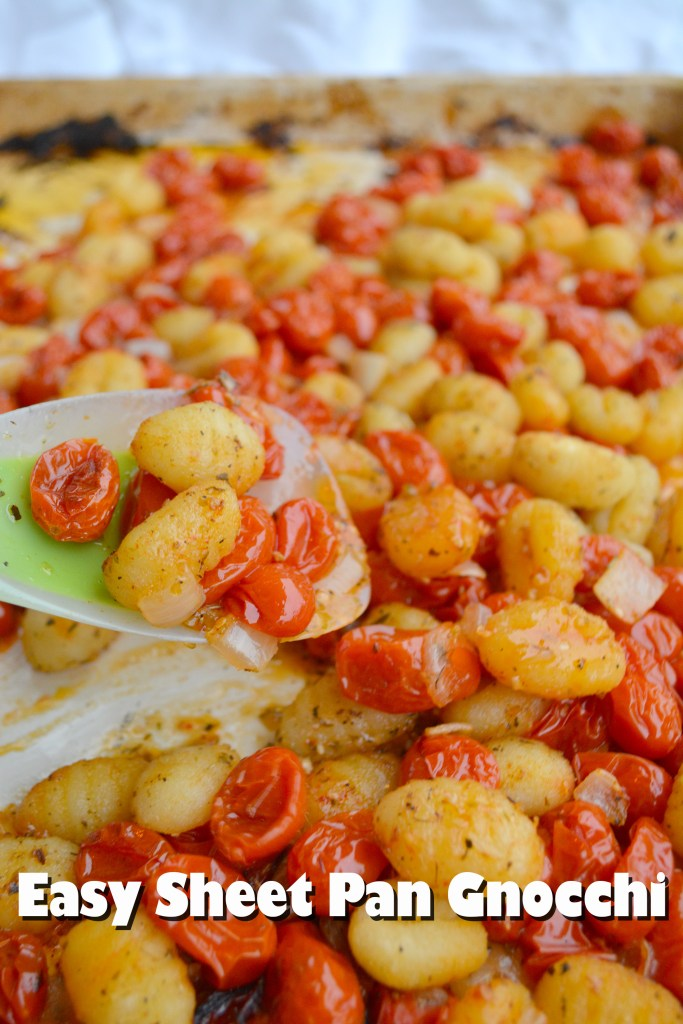"""Close up of pasta with fresh sauce with text labeling it """"Easy Sheet Pan Gnocchi""""."""