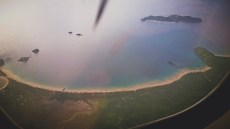 On our way home. Nacpan beach from outside the plane window.