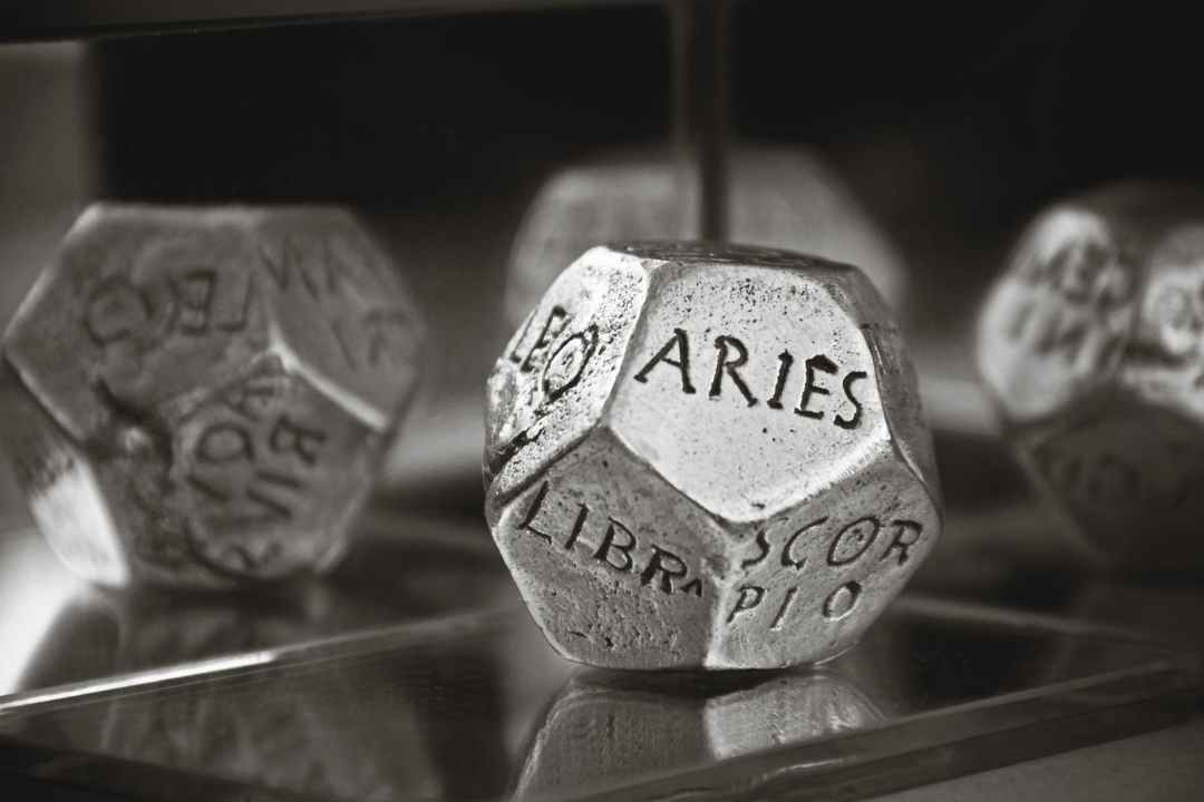 aries dice in gray scale photography