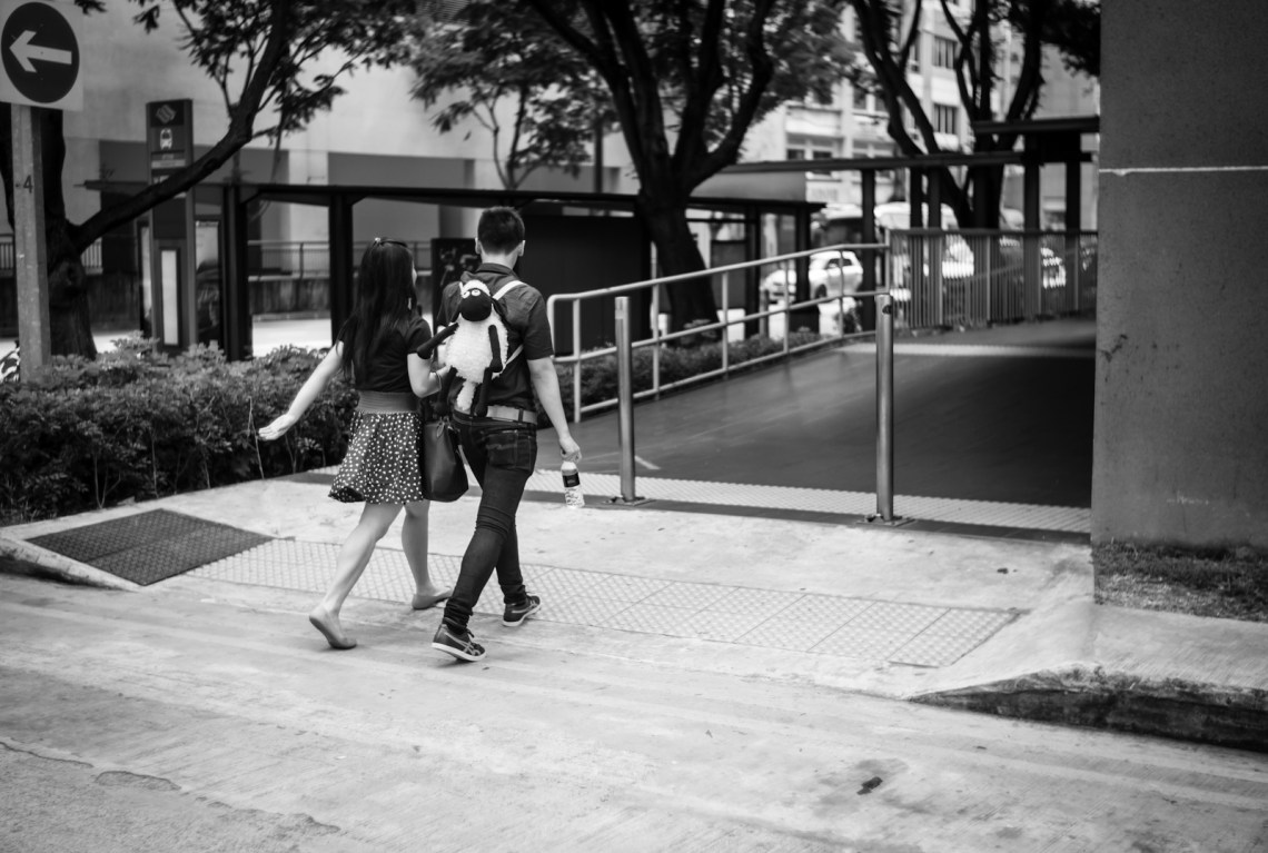 Street photography - Couple with a sheep backpack