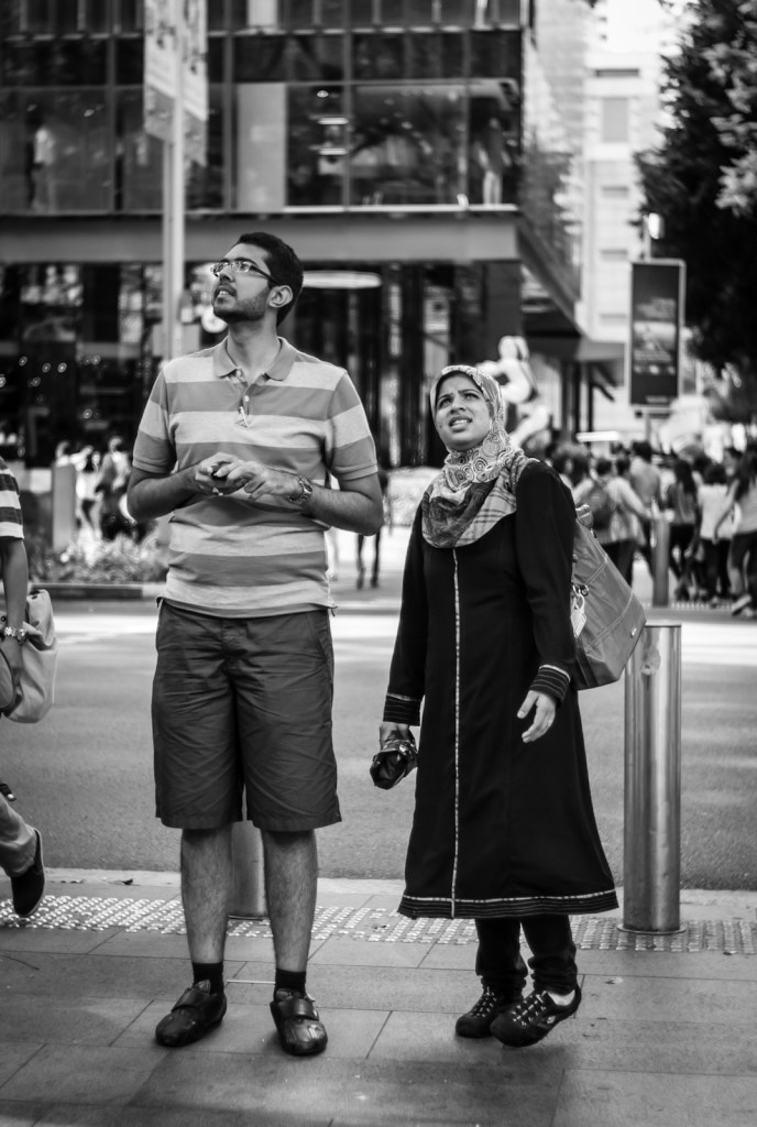Tourists in Orchard Road looking upwards