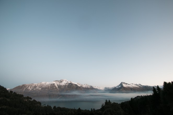 As the sunsets on Lake Wakatipu smoke settles over the mountains.