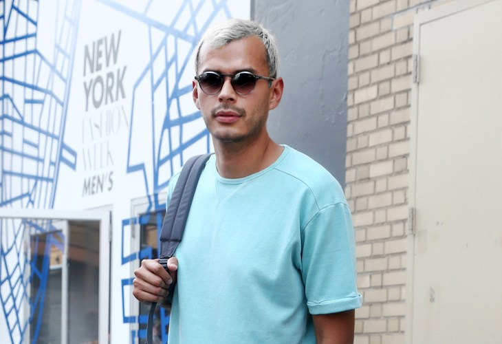 Jorge Gallegos wearing bright neon shirt outside of New York Fashion Week: Men's
