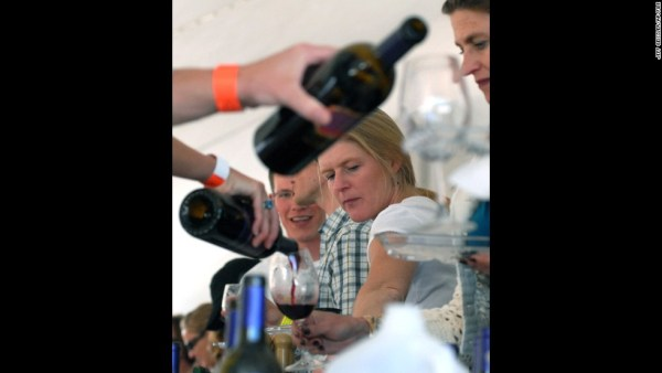 Kim Winters from Colorado Springs, Colo., looks over the wine choices during the Santa Fe Wine and Chile Festival in Santa Fe, NM on Saturday, Sept. 30, 2006. Ninety wineries and sixty restaurants from across the country participated in the event. (AP Photo/Jeff Geissler)