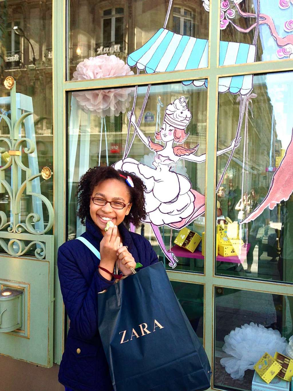 How To See Paris in 4 Days - eating a macaron on Champs-Élysées at Ladurée.