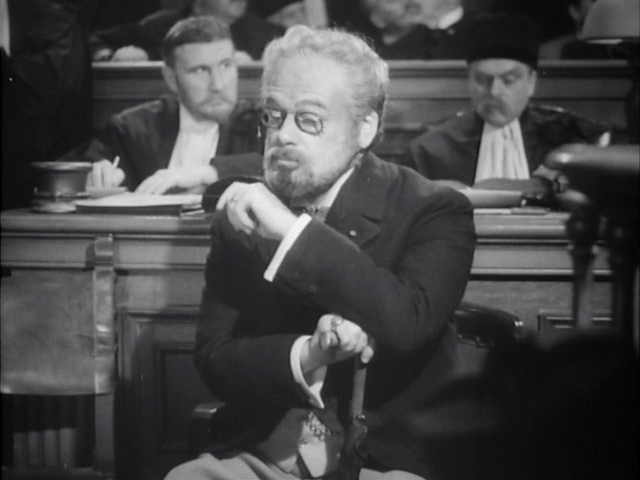 Paul Muni as Zola - listening at his trial