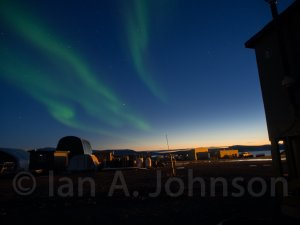 Aurora borealis in the sunset over Toolik Field Station