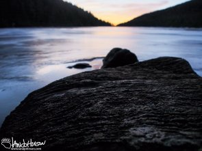 A sunrise and a frozen lake on a late fall morning at Moose Mountain, Appalachian Trial, Maine.