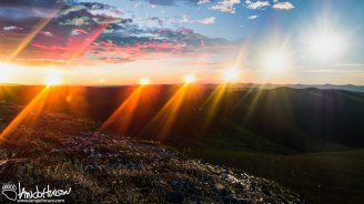 The sun swings low from Eagle Summit during the summer solstice north of the Arctic Circle.