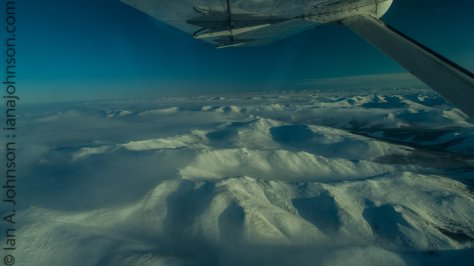 A juxtaposition of clouds and valleys. Shadows and light. It is quite stunning when you are up there looking down on it.