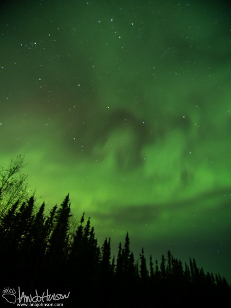 A moody green auroral sky. Not unlike a scene from a Ghostbusters movie :)