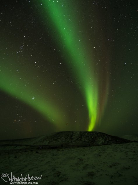 The aurora just starting to build over Eagle Summit, Alaska on 09/25/2014