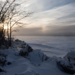 January 3rd : Cold whip up over Ottertail Lake in Minnesota. A sundog - the essence of cold weather- hangs in the sky