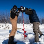 February 14th : Drilling holes in the Tanana River for burbot - needed some reach! Lots of ice.