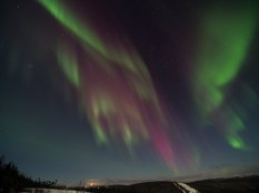 A full sky of red and green over Murphy Dome, Alaska