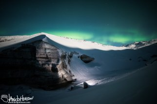 The aurora borealis over the face of Castner Glacier.