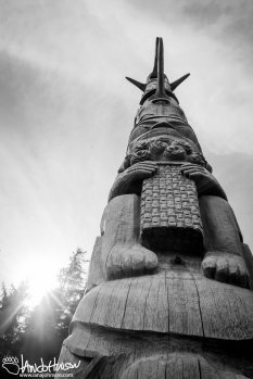 A tall and ornate totem in the village of Kasaan.