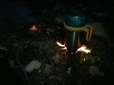 Boiling water for the next day while watching the fire die down. Common pre-bedtime activities.
