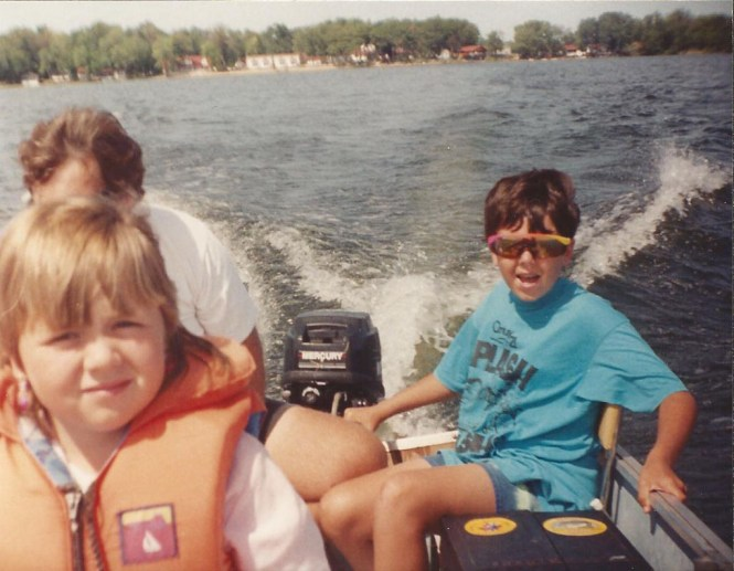 John Hadden 'driving' the boat on Sparrow Lake, Ontario with his sister Lisa enjoying the ride (Your Truly can be partially seen behind Lisa and Grandview Lodge Resort can be seen on the far shoreline)