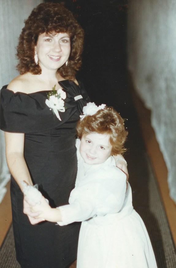 Lisa (Hadden) Donovan, the flower girl, dancing with her mom Karen (Benedetto) Hadden