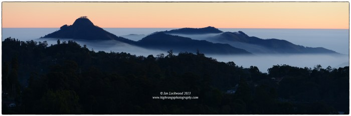 Perumal Peak (2,000 meters) the distinct mountain (that is NOT a volcano) of the Palani Hills rise above winter mist as seen from Kodaikanal int he early morning of December 30th.
