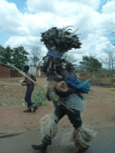Just outside Balaka we see Chewa Gulu Wamkulu folk on their way to a funeral