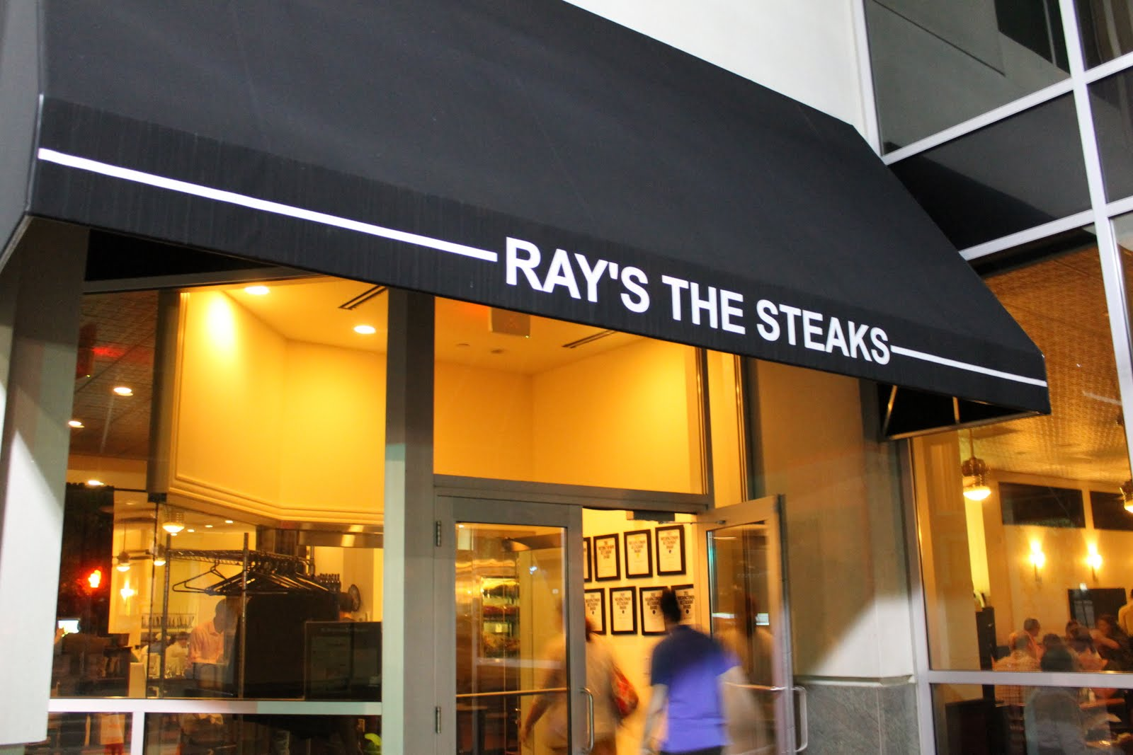 """Exterior photo of Ray's Steaks restaurant in Arlington, VA. Rays the Steaks, 2300 Wilson Boulevard, makes a return from its 2013 appearance on the Washingtonian's """"Very Best"""" list.  Seven total Arlington restaurants made the annual 100 Very Best Restaurants list of 2014. Joining Rays the Steaks, was Liam LaCivita's, Lyon Hall, Liberty Tavern and Ray's to the Third. Ray's to the Third just recently opened its doors in Rosslyn just a few short blocks away from Rays the Steaks, which is located at 2300 Wilson Boulevard.  According to the magazine, the consistency of Rays the Steaks kitchen and quality of the beef hasn't changed from last year's award-winning form. Their pepper-crusted filet mignon and mammoth cowboy-cut rib eye appear to be a guaranteed treat for 2015."""