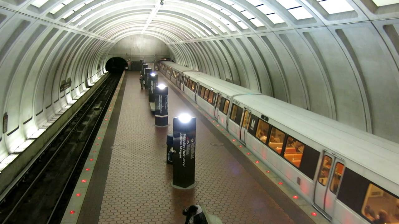 An image of a Metro train coming into the Woodley Park Station. Woodley Park (also known as Woodley Park–Zoo / Adams Morgan) is a station on the Red Line of the Washington Metro. Located at 24th Street and Connecticut Avenue Northwest, it serves the neighborhoods of Woodley Park and Adams Morgan in Northwest Washington.  With a vertical rise of 102 feet, the entrance escalators at Woodley Park are the longest in the District of Columbia and the third longest on the Metrorail system (behind Wheaton and Bethesda). The original escalators entered service when the station opened in 1981. On January 5, 2015, work began to replace the escalators, expected to run through mid-2018.