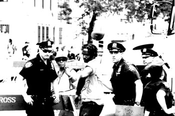 cop arresting black and white