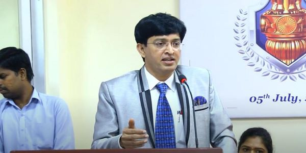 Dr. J Radhakrishnan IAS officer has worked towards reconstruction of the worst hit districts during the Indian Ocean flood. He also worked to save school children from a school fire.
