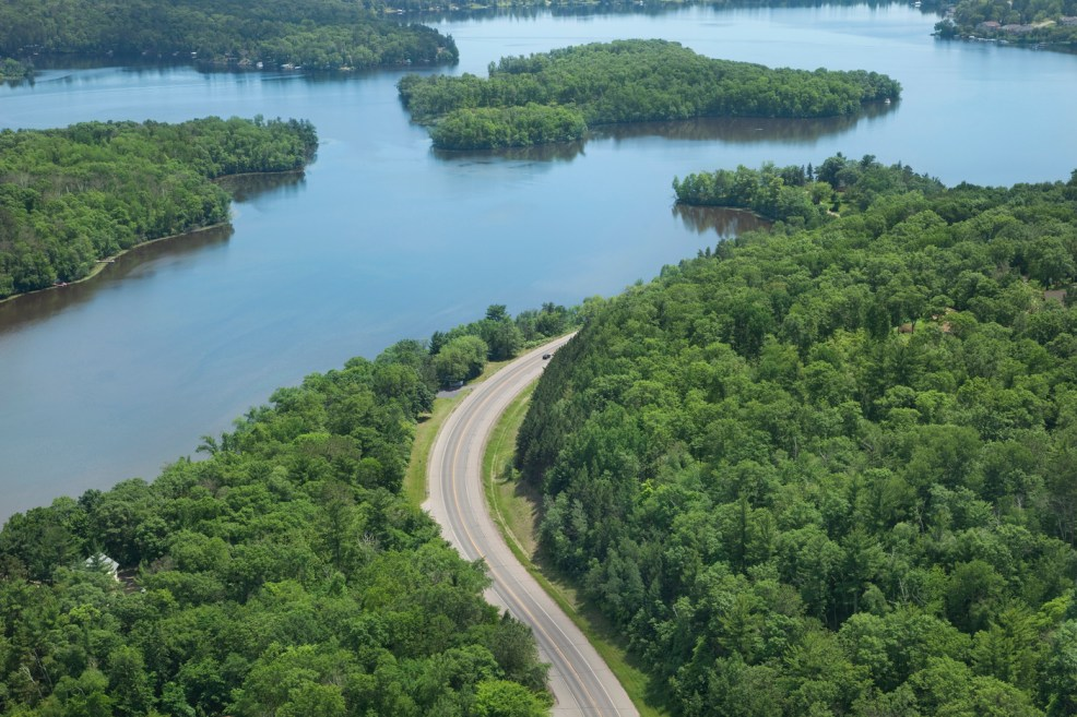 Mississippi river beside a road surrounded by trees. Another flood warning in Missour.