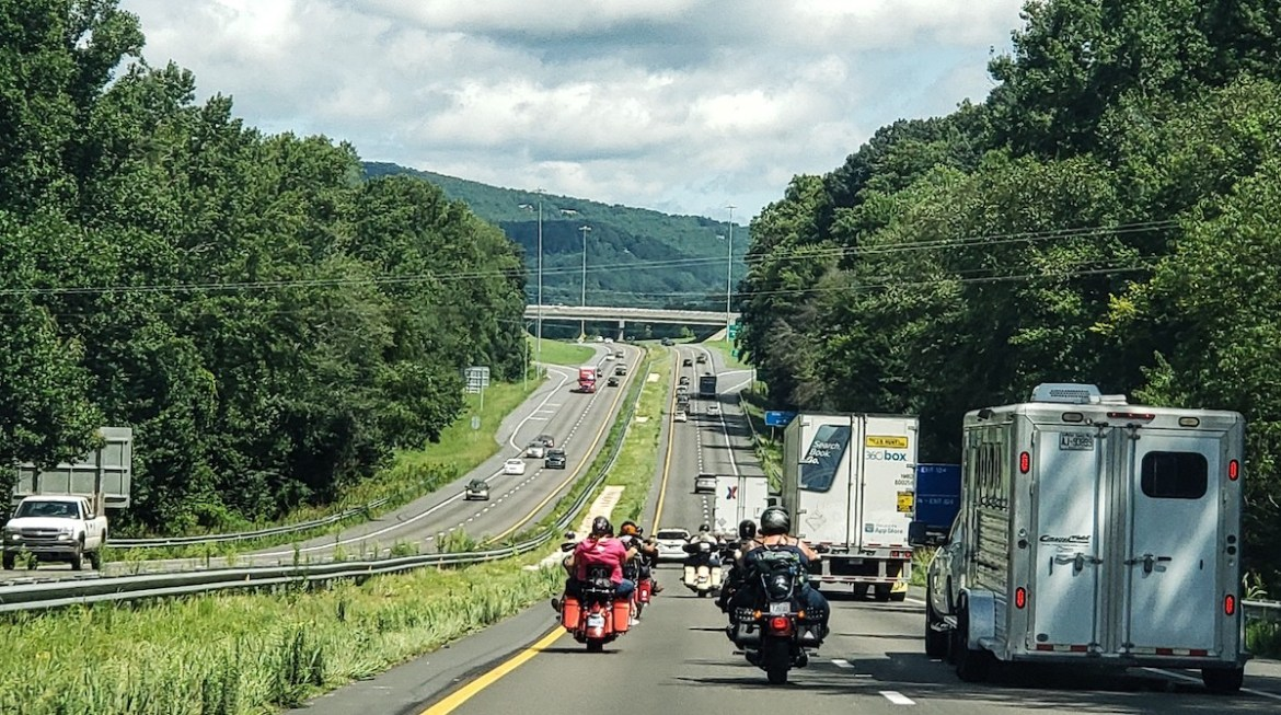 Motorcycles on the highway with increased following distance.