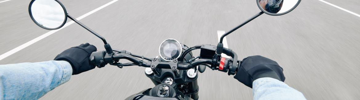 Handlebar of motorcycle while on the highway.