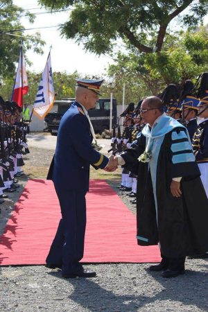 Dr. Jovenal B. Toring, Founder and President welcoming PNP OIC Leonardo Espina, guest of honor and speaker during the 22nd Commencement Exercises.